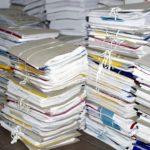 очень много стопок документов